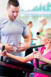 Woman with personal trainer doing sport Royalty Free Stock Image