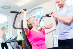 Woman with personal trainer doing sport Royalty Free Stock Photos