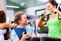 Woman with personal trainer doing sport und fitness royalty free stock photos