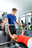 Woman and Personal Trainer in gym Royalty Free Stock Photos