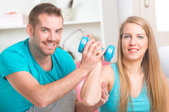 Woman with personal trainer at home Stock Photos