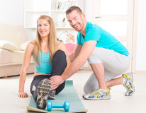 Woman with personal trainer at home Royalty Free Stock Images