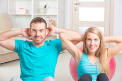 Woman with personal trainer at home Stock Images