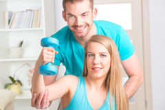 Woman with personal trainer at home Stock Photo