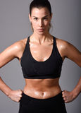 Woman, personal trainer, wearing black sportswear Royalty Free Stock Image