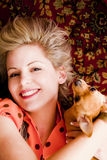 Woman and pet. Young blond beauty posing with her pet Stock Photo