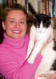 Woman with pet cat. Smiling attractive female holds her pet cat Stock Image