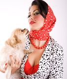 Woman and pet dog. Beautiful woman holding cute puppy royalty free stock images