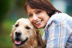 Woman With Pet Golden Retriever royalty free stock photos