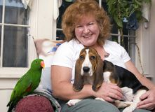 Woman with pets. A portrait of a smiling woman with her pets Royalty Free Stock Photography