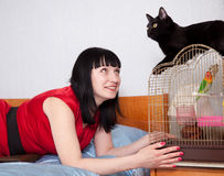 Woman with  pets in home. Woman in red with  pets in home Stock Photo