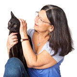 Woman Petting Black Cat Royalty Free Stock Images