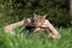 Woman petting cat in the garden Stock Photography