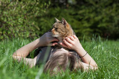 Woman petting cat in the garden Royalty Free Stock Photography