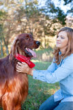 Woman petting dog Royalty Free Stock Photo
