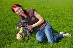 Woman petting dog on meadow Royalty Free Stock Photo