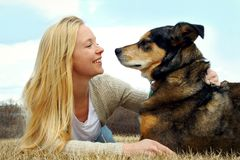 Woman Petting her German Shepherd Dog Outside Royalty Free Stock Photography