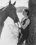 Woman petting horse Royalty Free Stock Images