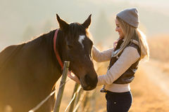 Woman petting horse farm. Pretty woman petting horse in the farm Royalty Free Stock Photography