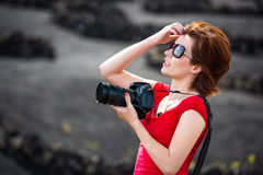 Woman with pfoto camera Royalty Free Stock Image