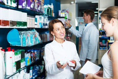 Woman pharmacist in drug store Royalty Free Stock Images