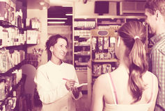 Woman pharmacist in drug store Royalty Free Stock Photo