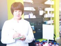 Woman pharmacist in pharmacy Stock Photography