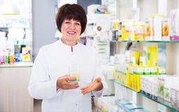 Woman pharmacist in pharmacy Stock Photos
