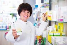 Woman pharmacist in pharmacy Royalty Free Stock Image