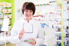 Woman pharmacist in pharmacy Stock Images