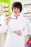 Woman pharmacist in pharmacy Royalty Free Stock Photos