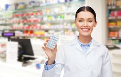 Woman pharmacist with pills drugstore or pharmacy Stock Images