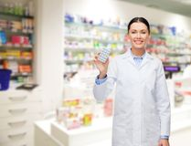 Woman pharmacist with pills drugstore or pharmacy Stock Photo