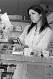 Woman pharmacist with prescription and medicine Royalty Free Stock Photo