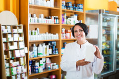 Woman pharmacist in store Royalty Free Stock Images