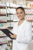 Woman Pharmacist whit clipboard Royalty Free Stock Photos
