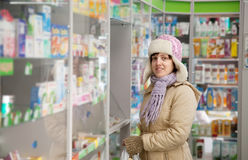 Woman  in pharmacy drugstore Stock Photos