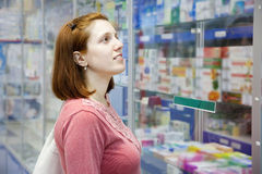 Woman  in pharmacy drugstore Royalty Free Stock Image
