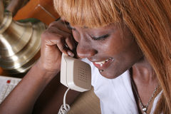 Woman on the phone. African American woman on the phone stock photos