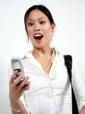 Woman and phone. A asian woman and a cell phone stock photos