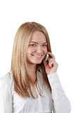 Woman on the phone. Portrait of a blonde young woman using a mobile phone isolated against  a white background Stock Photography