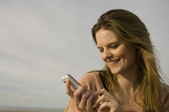 Happy woman with mobile Royalty Free Stock Image
