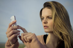 Young woman with mobile Stock Photography