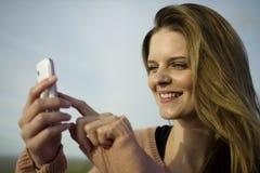 Happy woman using mobile Stock Photo