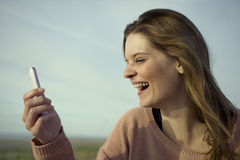Happy woman with mobile Stock Image