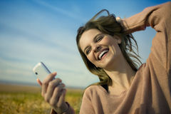 Happy woman with mobile Stock Photo