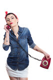 Woman with a phone. Woman with red kerchief holding a phone Royalty Free Stock Photos