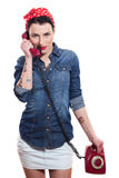 Woman with a phone. Woman with red kerchief talking on a phone Royalty Free Stock Photography