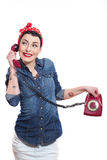 Woman with a phone. Woman with red kerchief holding a phone Stock Image