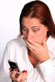 Woman with Phone. Woman surprised by telephone message stock photo